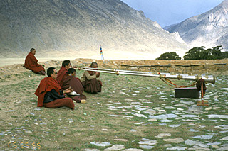 tibetan trumps resound troughout the mountains